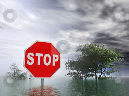 Flooding stock photo, Flooding with stop sign and trees under water by ngirl