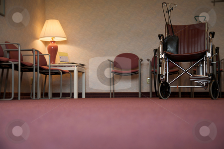 The waiting room stock photo, A doctor's office waiting room with a wheelchair - focus is on the wheelchair by Mitch Aunger