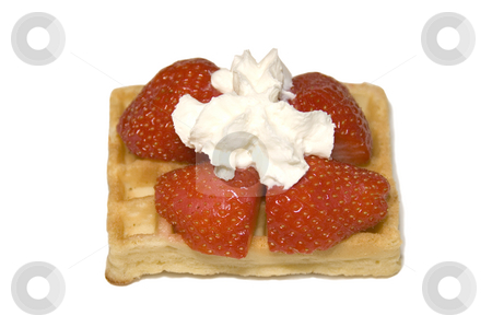 Belgium Waffle stock photo, Belgium waffle with strawberries and cream on it by Claudia Van Dijk