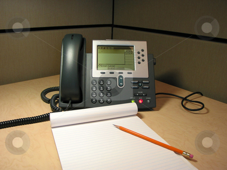 Customer support 2 stock photo, IP phone on the desk in the office with pencil and notepad by Elena Elisseeva