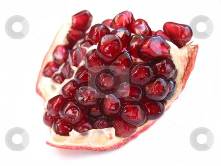 Pomegranate on white stock photo, A piece of open pomegranate with seeds isolated on white background by Elena Elisseeva