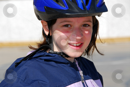 Girl portrait helmet stock photo, Portrait of a girl rollerblading in a helmet by Elena Elisseeva