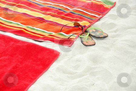 Beach towels on sand stock photo, Colorful beach towels on sandy beach by Elena Elisseeva