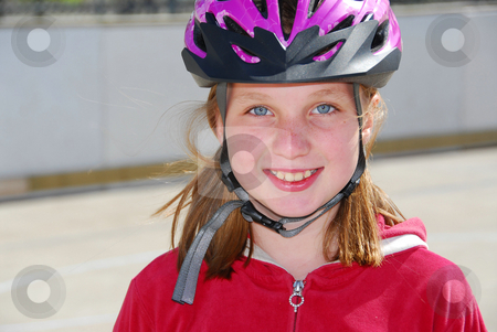 Girl child helmet stock photo, Portrait of a young girl rolleblading in a helmet by Elena Elisseeva