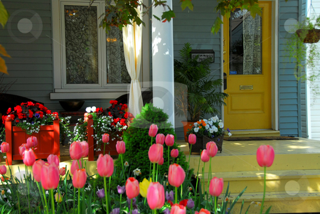 House porch with flowers stock photo, House porch with wicker furniture and flowers by Elena Elisseeva