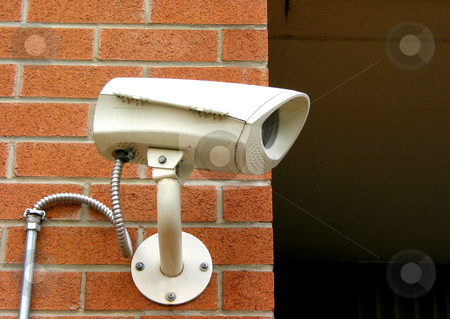 Security camera 1 stock photo, Security camera on a brick wall of a residential building by Elena Elisseeva