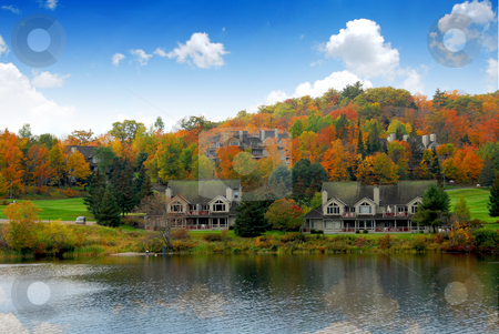 Luxury resort stock photo, Luxury resort on a lake in the fall by Elena Elisseeva