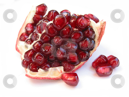 Pomegranate seeds on white stock photo, A piece of pomegranate with seeds closeup on white backgound by Elena Elisseeva