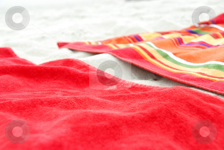 Beach towels on sand stock photo, Two colorful beach towels on sandy beach by Elena Elisseeva