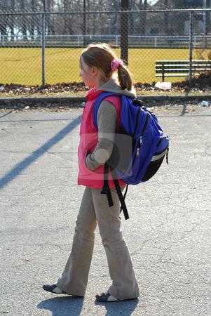 School girl stock photo, School girl walking by Elena Elisseeva