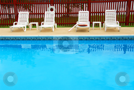 Swimming pool stock photo, Empty swimming pool in a luxury hotel by Elena Elisseeva