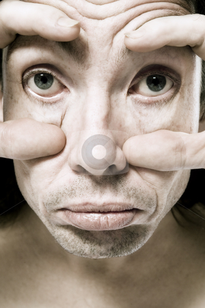 My big eyes stock photo, Funny man making huge eyes by Frenk and Danielle Kaufmann