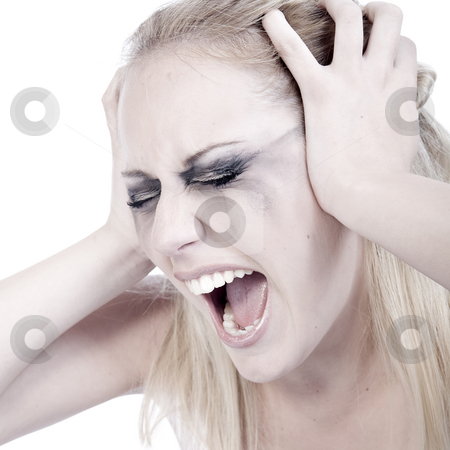 Studio portrait of a screaming young blond woman  stock photo, Studio portrait of a young blond woman screaming out loud by Frenk and Danielle Kaufmann