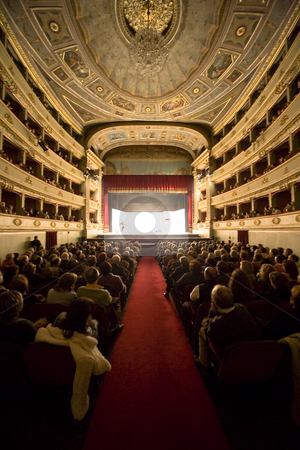 At the theatre stock photo, Historic theatre sold out and spectators watching the show by Luca Mosconi