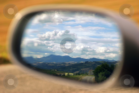 Landscape in the mirror stock photo, Landscape reflected in a car's mirror by Luca Mosconi