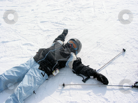 Girl ski winter stock photo, Young girl lying on the snow tired after a day of downhill skiing by Elena Elisseeva