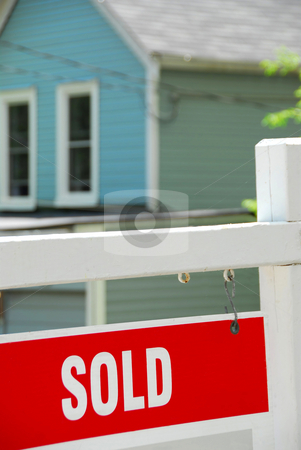Sold house stock photo, Sold sign near a house by Elena Elisseeva