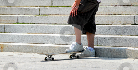 Skateboarder stock photo, Young man with standing on his skateboard by Elena Elisseeva