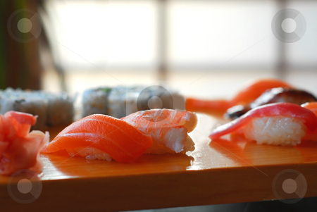 Sushi stock photo, Sushi on a wooden board by Elena Elisseeva