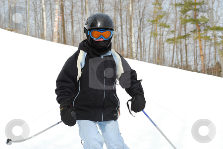 Girl skiing downhill stock photo, Young girl skiing downhill by Elena Elisseeva