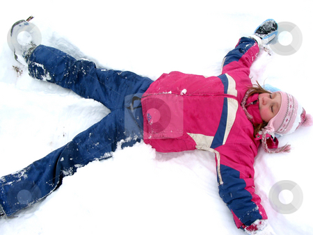 Winter snow angel stock photo, Winter fun: young girl making a snow angel on fresh white snow by Elena Elisseeva