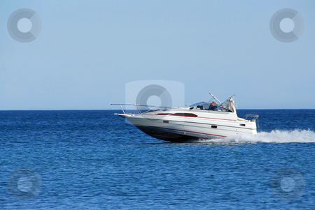 Speed boat stock photo, Fast moving speedboat by Elena Elisseeva