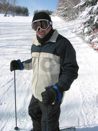 Skier  stock photo, Happy man enjoying downhill skiing by Elena Elisseeva