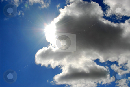 Sun sky clouds stock photo, Sun coming out of the clouds in bright blue sky by Elena Elisseeva