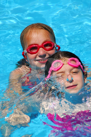 Two girls pool stock photo, Two young girls having fun in a swimming pool by Elena Elisseeva