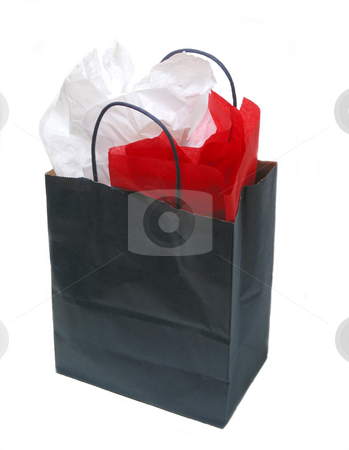 Paper shopping bag with tissue stock photo, Blank blue shopping bag isolated on white background with tissue paper by Elena Elisseeva