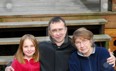 Three generations stock photo, Daughter, father and grandmother on the deck stairs by Elena Elisseeva
