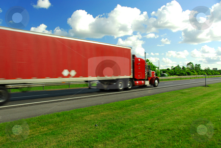 Fast moving truck stock photo, Fast moving truck with red container on highway, blurred because of fast motion by Elena Elisseeva