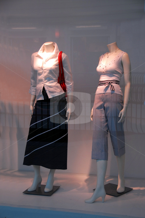 Store window stock photo, Store window with dressed mannequins in shopping mall by Elena Elisseeva