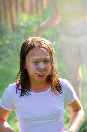 Girl and sprinkler stock photo, Girls running though a sprinkler by Elena Elisseeva