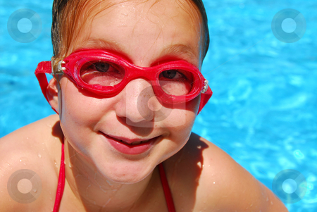 Girl child pool stock photo, Portrait of a smiling girl in red goggles by Elena Elisseeva