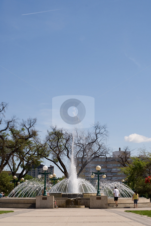 Fountain stock photo, A large water fountain shot during the day, with additional space for the text in the sky by Richard Nelson