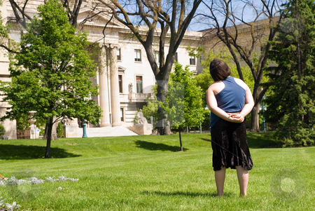 Tourist stock photo, A female tourist taking in the view of a large historic building by Richard Nelson