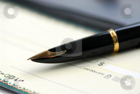 Checkbook pen stock photo, Gold fountain pen and cheque by Elena Elisseeva