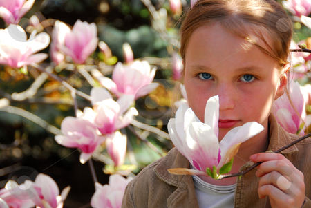 Girl with magnolia stock photo, Beautiful young girl with pink magnolia flower by Elena Elisseeva