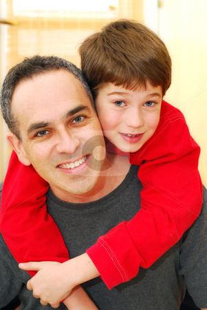 Father son portrait stock photo, Portrait of smiling father and son inside by Elena Elisseeva