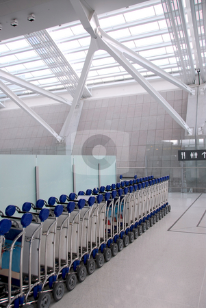 Luggage carts airport stock photo, Luggage carts inside modern international airport by Elena Elisseeva