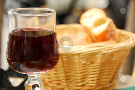 Wine and bread stock photo, Glass of young red wine and fresh bread by Elena Elisseeva