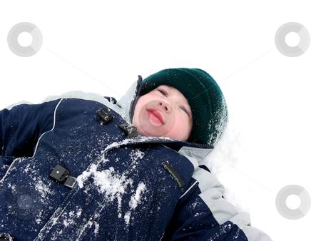 Boy child winter fun stock photo, Young boy lying in snow enjoying winter by Elena Elisseeva