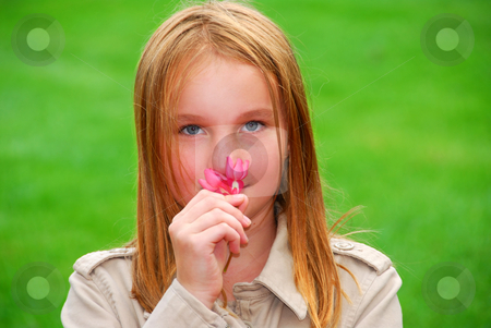 Girl flower stock photo, Young girl holding a pink flower in her hand by Elena Elisseeva
