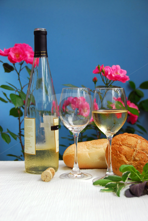 White wine with glasses stock photo, White wine with glasses on blue background by Elena Elisseeva