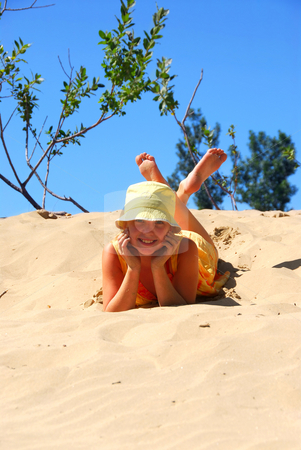 Girl beach stock photo, Young girl lying on top of a sand dune by Elena Elisseeva
