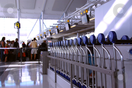 Airport crowd stock photo, Passengers lining up at the check-in counter at the modern international airport by Elena Elisseeva