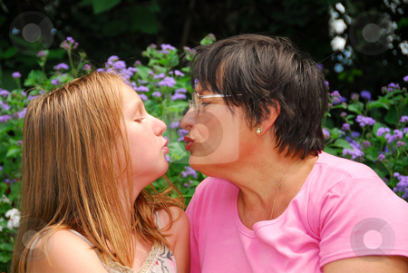 Family generations stock photo, Portrait of grandmother and granddaughter in a garden by Elena Elisseeva