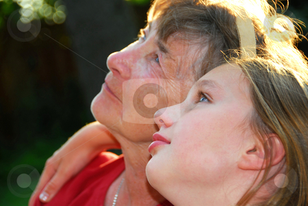 Generation stock photo, Portrait of a grandmother and granddaughter looking up with hope by Elena Elisseeva