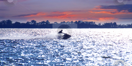 Jetski stock photo, Man on jet ski at sunset by Elena Elisseeva